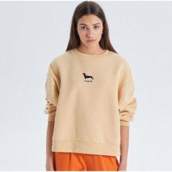 ee184e055c5711 Bluza oversize z nadrukiem - Beżowy. Bluzy bez kaptura damskie marki Cropp.  W wyprzedaży