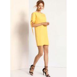 f56ac003c3 Żółte sukienki damskie ze sklepu Top Secret - Kolekcja wiosna 2019 ...