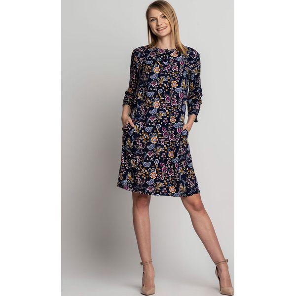 7ca636d004dc78 Sukienka z pęknięciem przy dekolcie i rękawem 3/4 BIALCON - Sukienki ...