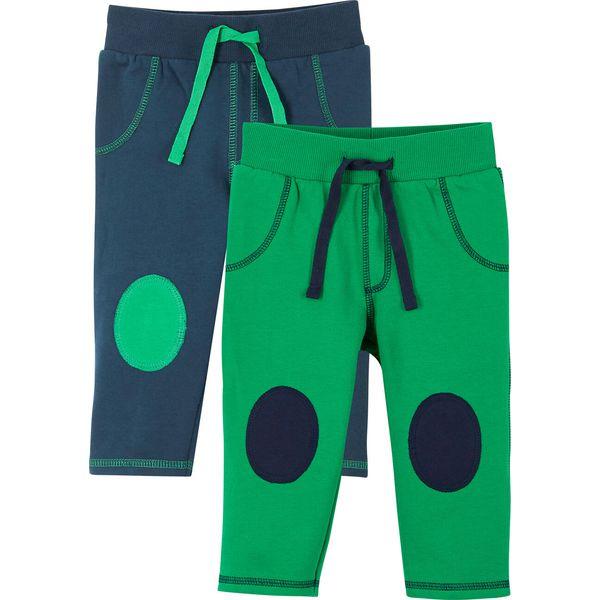Spodnie dresowe niemowlęce (2 pary), bawełna organiczna bonprix ciemnoniebieski + zieleń trawy