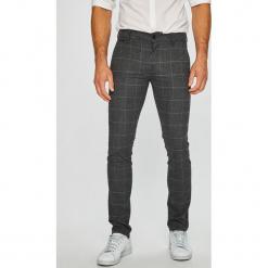 ab2793740a6d Spodnie materiałowe męskie marki Guess Jeans - Kolekcja wiosna 2019 ...
