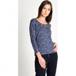 78f3f5a42d Bluzka ze wzorem z łezkami na dekolcie QUIOSQUE. Bluzki damskie marki  QUIOSQUE. W wyprzedaży