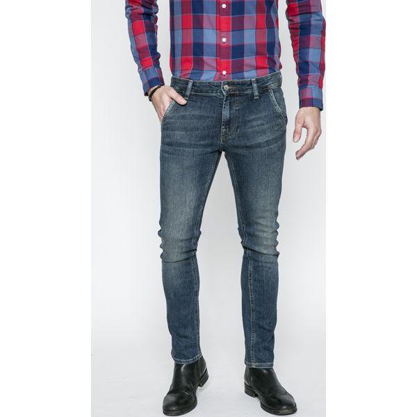 5193a407de584 Guess Jeans - Jeansy Adam - Jeansy męskie marki Guess Jeans. W wyprzedaży  za 229.90 zł. - Jeansy męskie - Spodnie męskie - Odzież męska - Mężczyzna -  Sklep ...
