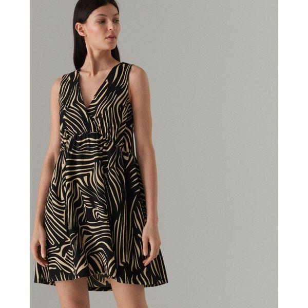 33213bd14f Rozkloszowana sukienka we wzory - Biały - Sukienki damskie marki ...