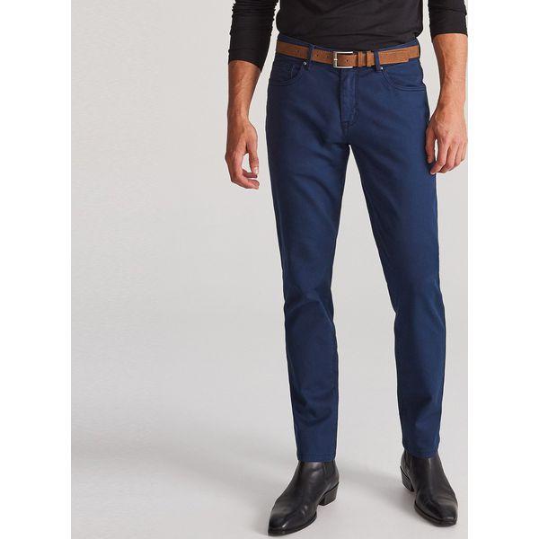 Bawełniane spodnie z paskiem Granatowy