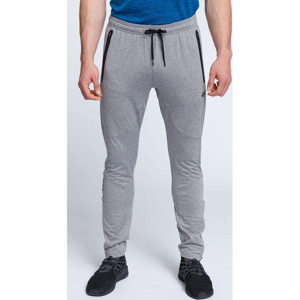 9bd368490 Spodnie treningowe męskie SPMTR200 - średni szary melanż - Spodnie  materiałowe męskie marki 4f. W wyprzedaży za 99.99 zł.