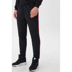 56a8c5fe35b59 Spodnie materiałowe męskie ze sklepu House - Kolekcja wiosna 2019 ...
