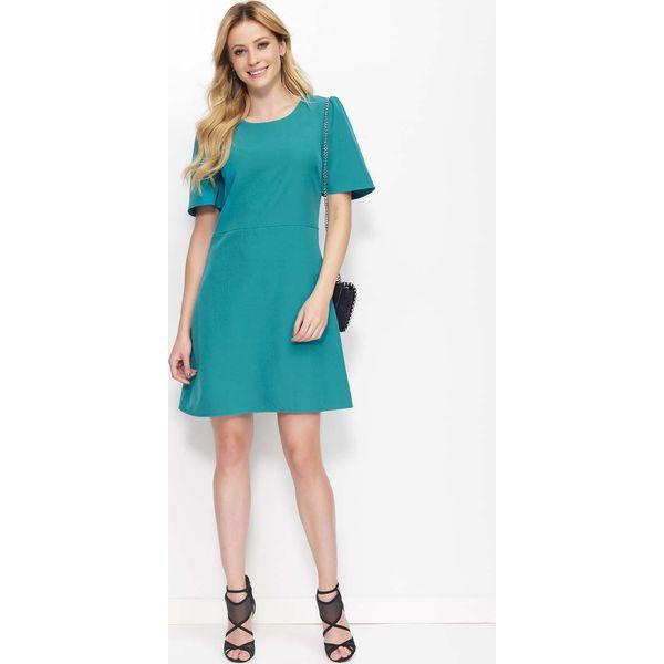 1becc84e53 Zielona Sukienka Trapezowa z Kloszowanym Rękawem - Sukienki damskie ...
