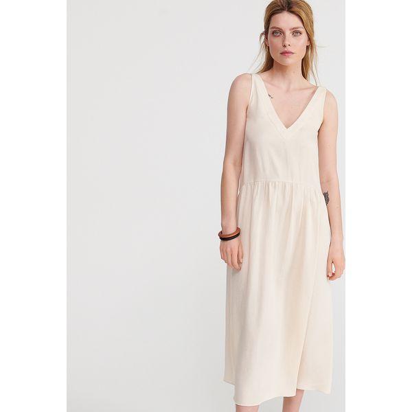 c04111ad65 Gładka sukienka midi - Kremowy - Sukienki damskie marki Reserved. Za ...